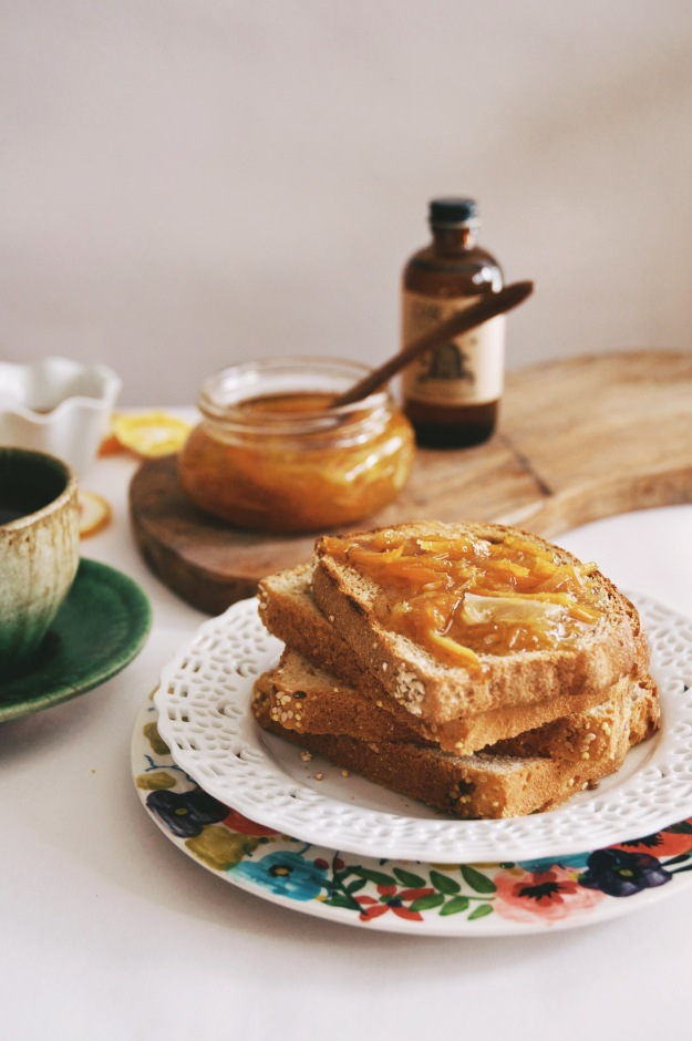 stack of toast with jar of marmalade