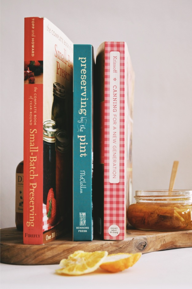 three books on preserving stacked in a row
