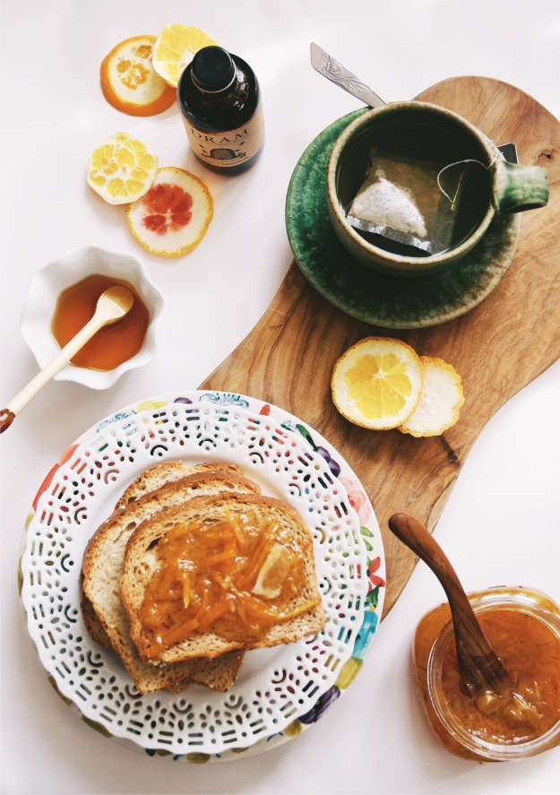 plate of toast with marmalade and tea